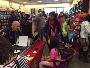 Trooper Martin Miller from Rockford Post/ Michigan State Police fingerprints children